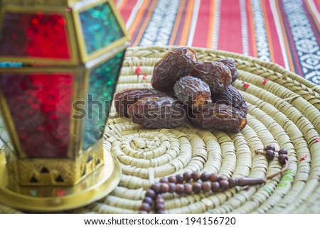Close up of an arabic dates, lantern and prayer beads - stock photo