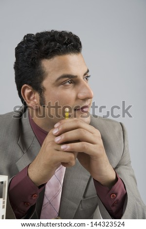 Close-up of an architect in thoughts - stock photo