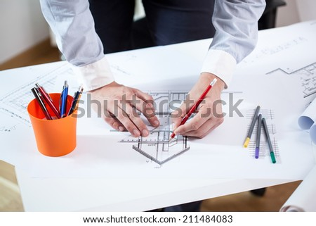 Close-up of an architect working on house