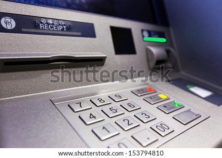Close up of an ATM machine. Keyboard and insert card  - stock photo
