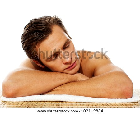 Close-up of an attractive man resting in a spa center - stock photo