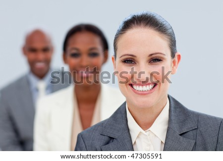 Close-up of an attractive manager and her team  standing