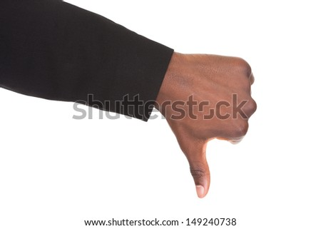 Close-up Of An Businessman's Hand Showing Thumb Down Sign Isolated Over White Background - stock photo