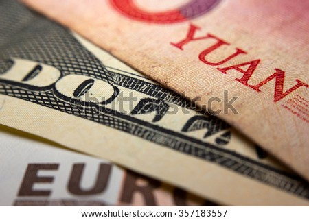 Close-up of an Chinese yuan, an American dollar and a Euro banknote