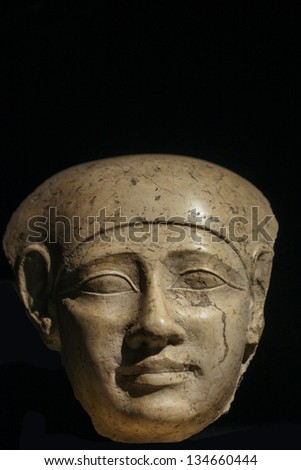 Close up of an Egyptian stone head of 400 BC - stock photo