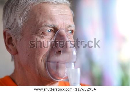 close-up of an elderly man doing inhalation - stock photo