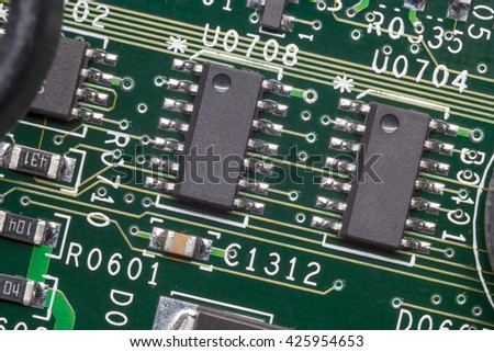 Close up of an electronic circuit board, chip in an electronic circuit board