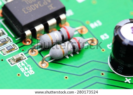 Close up of an electronic circuit board,Power Resistor in an electronic circuit board - stock photo