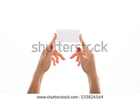 Close-up of an empty business card in a woman's hand isolated - stock photo