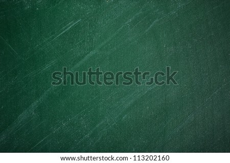 close up of an empty school green chalkboard - stock photo