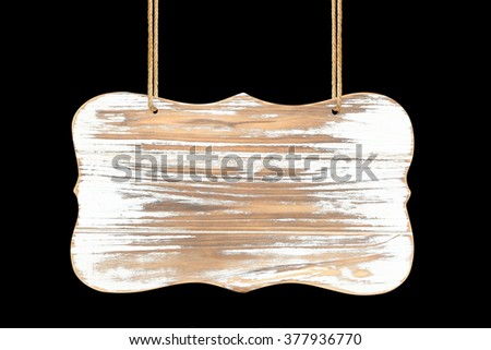 close up of an empty wooden sign hanging on a rope on black background - stock photo
