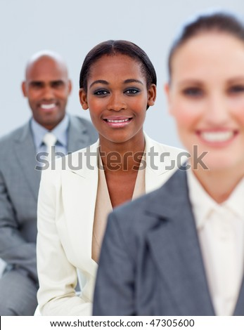 Close-up of an ethnic manager and her team  standing