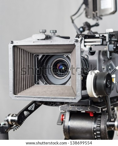 close up of an expensive cinema camera with accesories - stock photo