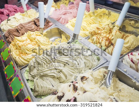 Close-up of an ice cream counter with variety of flavours - stock photo