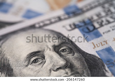 Close-up of an image of Benjamin Franklin on a dollar bill / studio photography of American moneys of hundred dollar  - stock photo