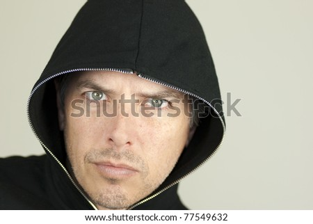 Close-up of an intense man looking to camera. - stock photo