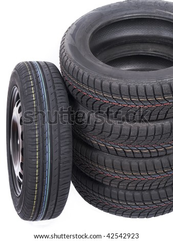 Close up of an isolated wheel and stacked tyres