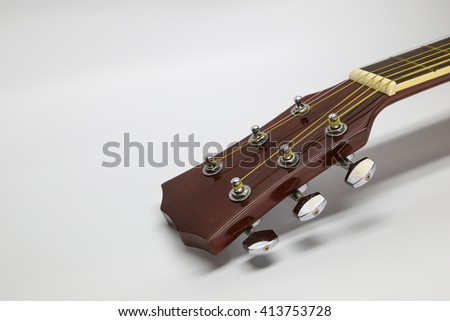 Close up of an new acoustic guitar head - stock photo