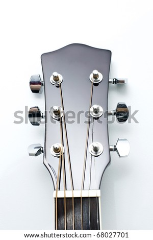 Close up of an new acoustic guitar head,  isolated on white background. - stock photo