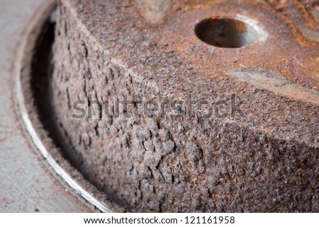 Close-up of an obsolete and rusty brake disk - stock photo