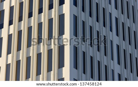 Close up of an office building with multiple floors. - stock photo