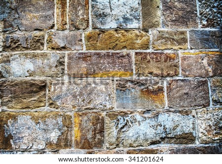 close up of an old brick wall in hdr tone mapping effect - stock photo