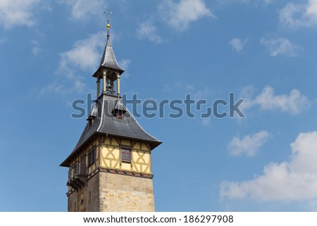 Close up of an old city tower against blue sky in Germany - stock photo