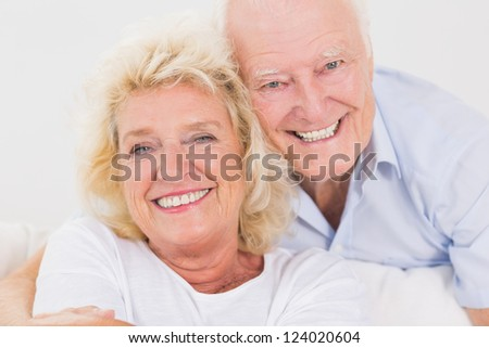 Close up of an old couple portrait hugging
