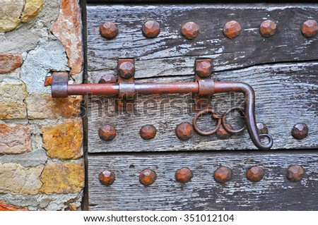 close up of an old deadbolt in a wooden door - stock photo