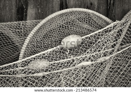 close-up of an old fishing net - stock photo