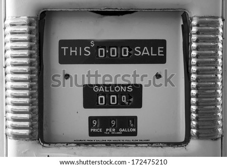 Close up of an old gas pump in black and white - stock photo
