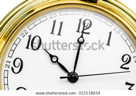 Close up of an Old gold clock face at 10 AM. - stock photo