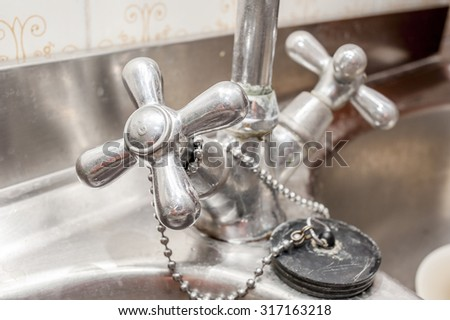 Close up of an old handle kitchen faucet - stock photo
