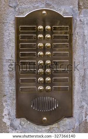 Close up of an old intercom - stock photo