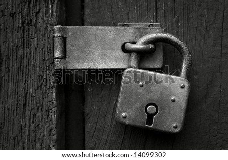Close-up of an old padlock in B&W - stock photo