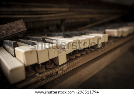 Close-up of an old piano keyboard. Chernobyl nuclear power plant zone of alienation - stock photo