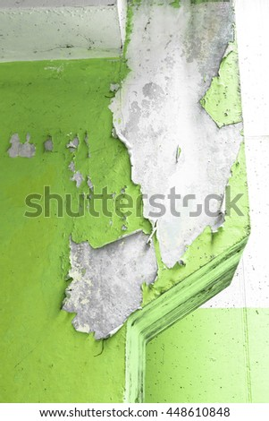 Close up of an old pillar with green peeling paint - stock photo