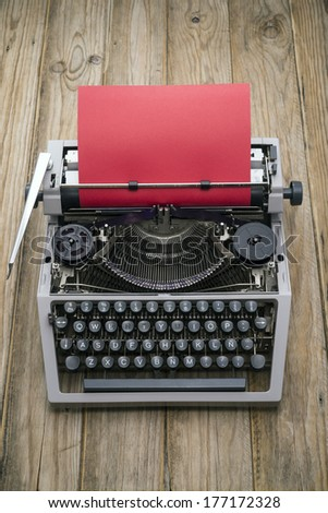 Close up of an old typewriter and red paper - stock photo