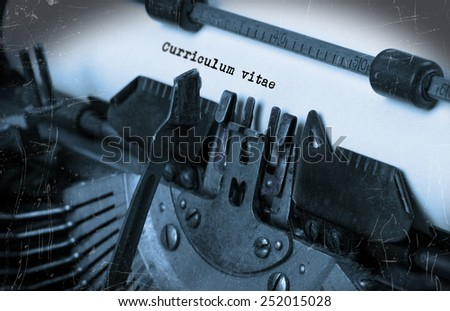 Close-up of an old typewriter with paper, perspective, selective focus, curriculum vitae - stock photo