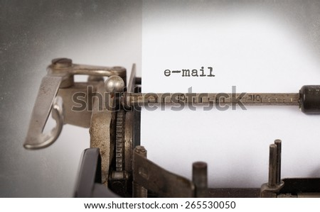 Close-up of an old typewriter with paper, perspective, selective focus, e-mail - stock photo