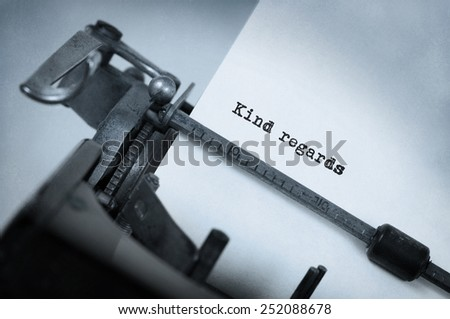 Close-up of an old typewriter with paper, selective focus, Kind regards