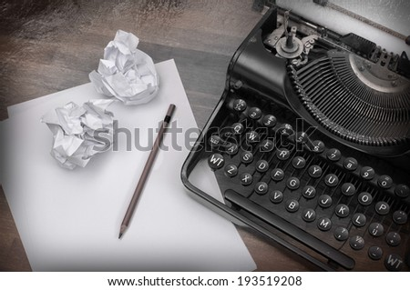 Close-up of an old typewriter with paper, vintage look, cold - stock photo