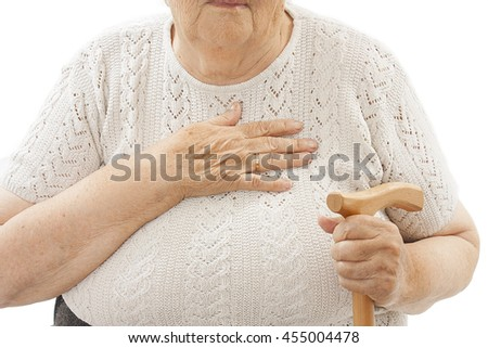 Close up of an old woman's hands over her chest. Isolated on white background