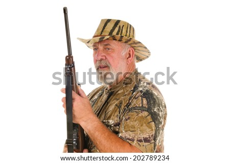 close-up of an older hunter  holding a rifle ready to shoot., isolated on white - stock photo