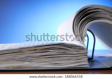 Close up of an opened document file. - stock photo