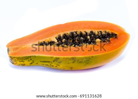 close up of an organic papaya cut in half showing the seeds isolate don a white background