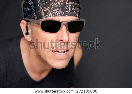 Close-up of an out of breath intense athletic man. - stock photo