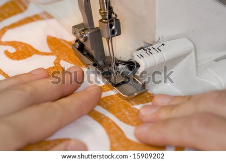 Close up of an overlock sewing machine in use