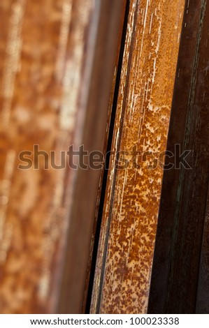 Close-up of an oxidised iron column - stock photo