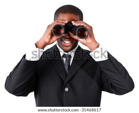 Close-up of an smiling Afro-American businessman looking through binoculars - stock photo